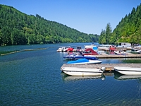 boats line docks extending into North Fork Reservoir