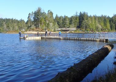 A few people fish from the pier at Cleawox Lake