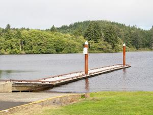 a pier extends next to a boat ramp on Cullaby Lake