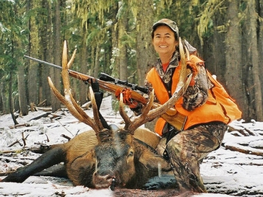 Successful hunter with a Cascade elk