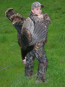 Hunter Pariani 10 poses with a shot turkey