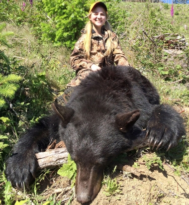 Image of a girl with a large black bear