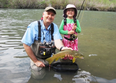 child and grandfather with an Owyhee River brown trout