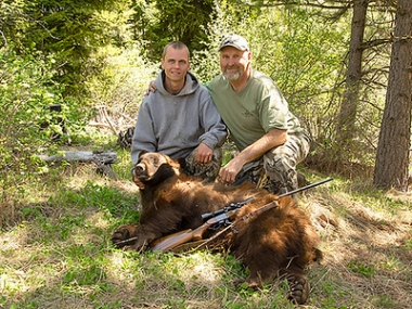 Ronald and Luke French with the spring bear they took in the Chesnimus Unit.