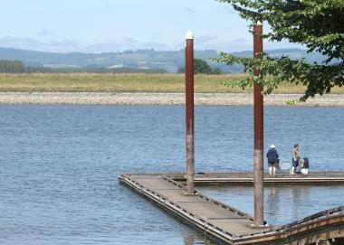 A family stands on a dock on the Gilbert River