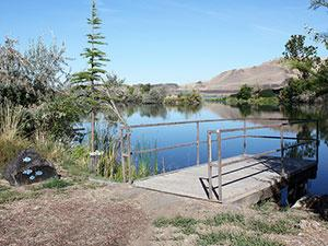 A fishing dock extends into McNary Pond