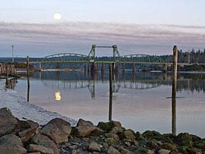 A photo of a bridge crossing the Coquille River.