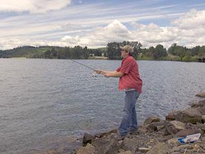 A woman casts a line into Dexter Reservoir