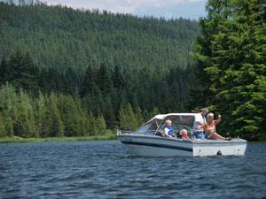 a family on a small motor boat on Timothy Lake