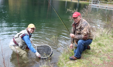 Angler gets help landing fish at Wizard Falls workshop
