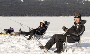 Two anglers ice fishing on Diamond Lake