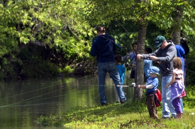 Family fishing at Alton Baker Canoe Canal