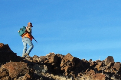 imgae of a chukar hunter on a rocky ridge