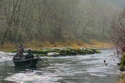 Image shows two anglers floating on the Alsea River