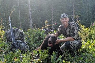 Image of a bear hunter with a spring black bear