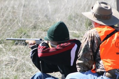 image of hunter ed instructor coaching a student shooting