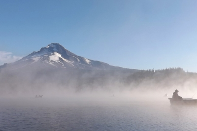 mage of boat anglers on Trillium Lake, Mt Hood in background