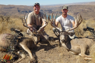 Photo of two archery hunters with their mule deer
