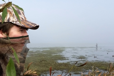 photo of a Coquille Valley duck hunter scanning the water