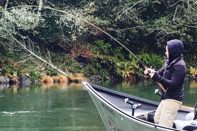 image of a boat angler fighting a Chinook salmon