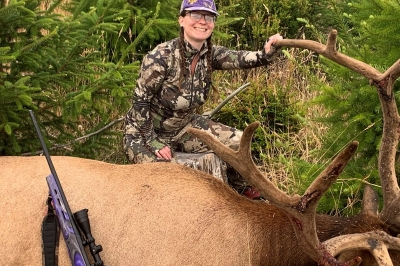 Photo of hunter with a giant bull elk taken in the Sixes unit